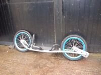 BMX style standing DIRT SURFER, like a scooter on steroids, step up from mountain boarding