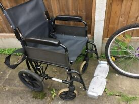mobility black wheel chair used but still in good condition and with seat pad