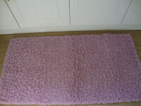 Vista Shaggy Pink Rugs x 2. Good condition size 80 x 150. Used in Bedroom.