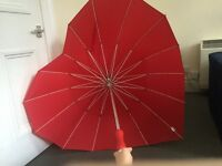 Red heart shaped umbrella for sell