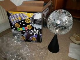 Glitter mirror ball and colourful lamp