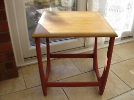 refurbished table in fire red