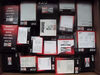 Box of 37 Champion oil filters for older vehicles