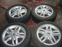 Renault Clio 15 inch Alloy Wheels with Bolts Two New Tyres two Half Worn Would fit other models