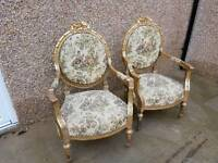 Pair of antique gilt wood arm chairs