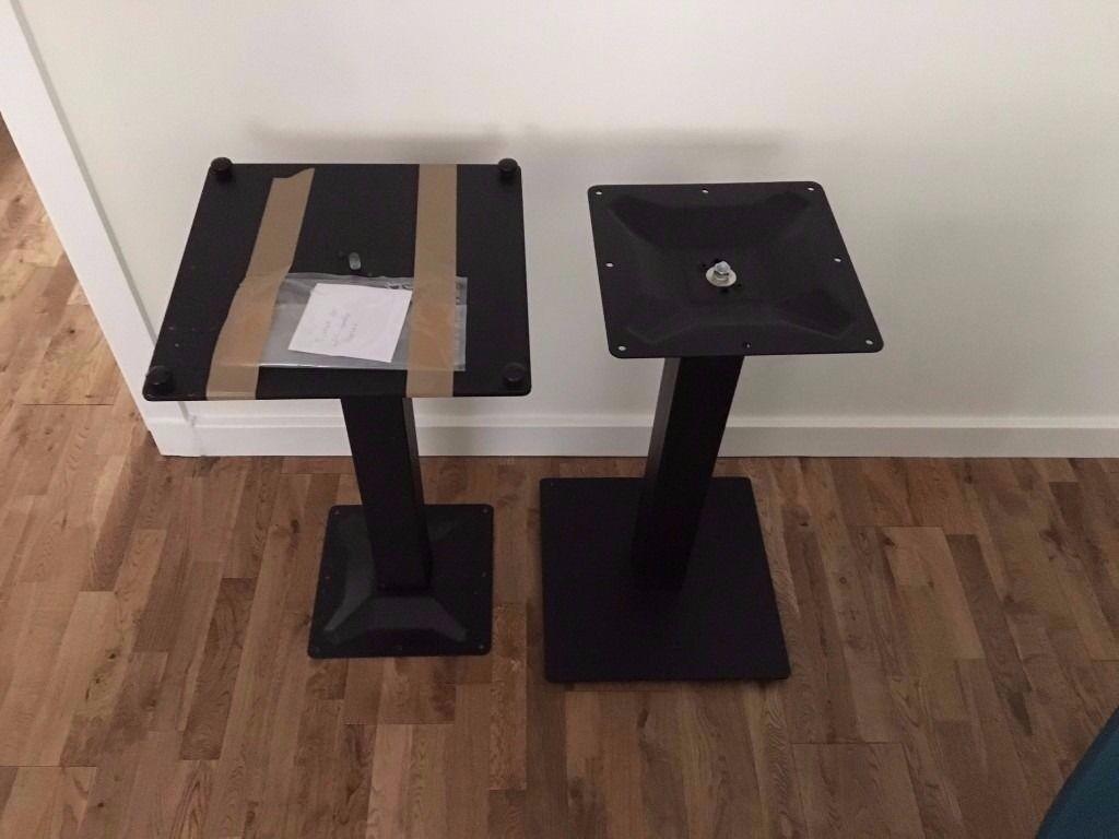 pair of black metal table bases