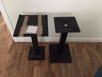 pair of black metal table bases