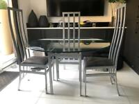 Grey metal base table with glass top / dining table / glass table / grey / chairs /