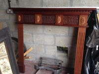 Tiled fireplace and wood surround