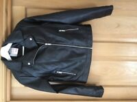 Unworn labels attached, Primark age 13-14 years faux leather black bikers' jacket.
