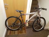 Carrera Vulcan mountain bike with 26 inch wheel size and 20 inch frame.
