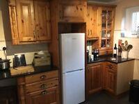 Solid wood kitchen with granite worktops