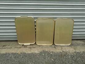 Three metal trays