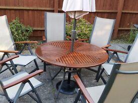 Round garden table + 6 chairs + umbrella