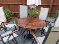 Round garden table + 6 chairs + parasol