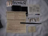 Calligraphy pen + 6 gold plated nibs in storage box, with some lettering to copy, used