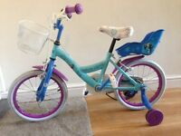 Frozen child's bike .with frozen helmet Hardly used . Immaculate