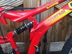 """Red Bike Dual Suspension Polaris Universal 17"""" frame. 26"""" wheel"""
