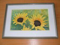 Beautiful framed print of sunflowers.