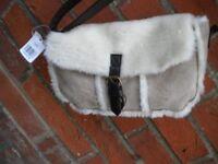 A WONDERFUL SHEEP SKIN BAG