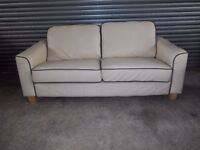 Two Ivory Leather Sofas (Suite) with matching Footstool