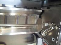 Kebab machine (1 day old . 12 month gaurantee . Comes with new electric kebab slicer. 4 burner gas.
