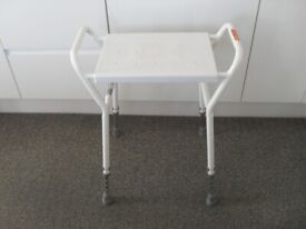 White adjustable shower stool in as new condition.