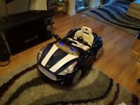 Brand new children's ride on sports car, never been used.parental control and charger included