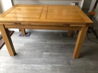 Natural solid oak extending table with 6 chairs