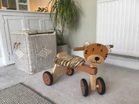 Children's wooden ride on tiger