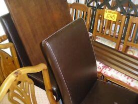 TABLE AND 2 LEATHER CHAIRS at Haven Housing Trust's charity shop