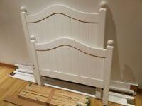 single wood frame bed