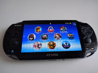 PS Vita (OLED) + 16GB Memory card + 66 Games!!!