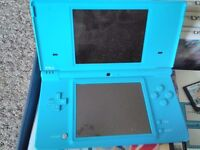 Blue dsi with box and 13 games