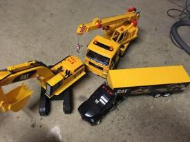 Large caterpillar construction and transportation vehicles