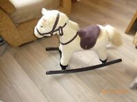 Rocking Horse, press ears to hear it neigh. Excellent condition. £15