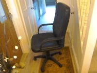 V good condition swivel chair in black leather look