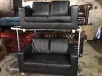 🎅2 black leather 2 seater sofas