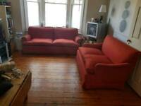 Red 2 seater and 3 seater sofa