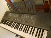 yamaha psr300 full size digital keyboard,various voices,styles,built in stereo speakers,mains supply