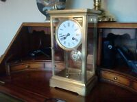 antique 4 glass. french brass library clock. with military insignia pendulum. by japy freres .