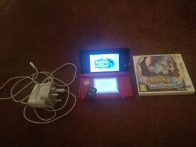 Red Nintendo 3ds for sale with pokemon moon