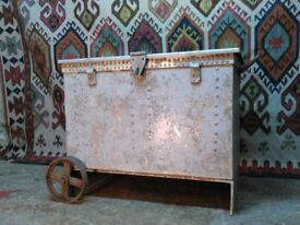 Large vintage metal chest with nautical history. fitted with cast iron wheels perfect log store