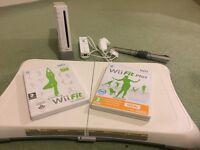 Nintendo Wii + wii fit plus + guitar hero