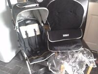 Childrens Stroller Age 6 months - 4 years Bruin Black buggy with winter footmuff + raincover pram