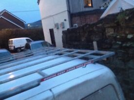 Bolton roof rack with roller on good condition cost 315£ wen new want 150£ for it