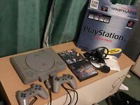 PlayStation 1 boxed, 2 controllers, 2 games