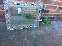 One silver gilt effect wooden mirror