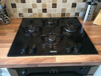 Zanussi 4 burner black glass gas hob with black enamel pan supports. Excellent condition