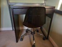 Black IKEA desk and swivel chair